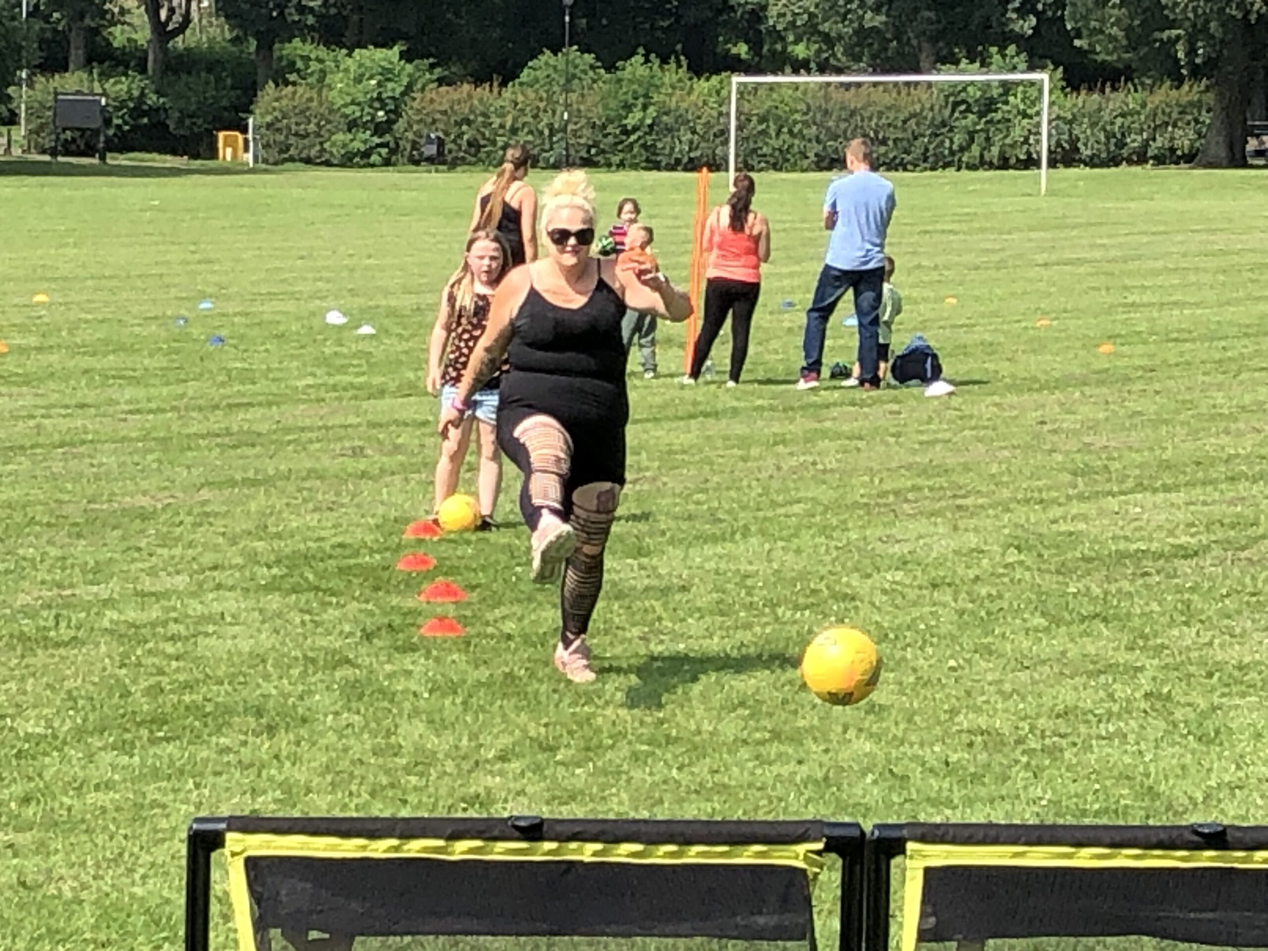 Image of a woman kicking a ball at Fun, Food and Film Project